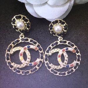 big round Chanel earrings